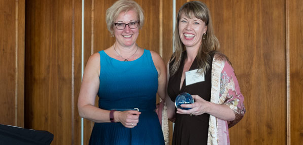 Laurie Dawkins (right) accepts Lighthouse Award from IABC BC chapter president Catherine Ducharme.